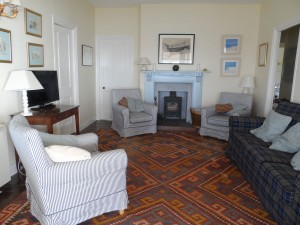 Sitting room with wood burner & wide screen TV